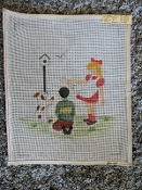 A NeedlePoint Design of 2 Kids With a Dog Bone 'NeedlePoint_857'